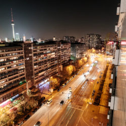 Concrete building and night traffic of Leipziger Straße