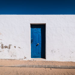 Entrance of a typically blue-white coloured house on Canary Islands